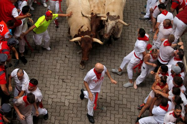 people running away from bulls