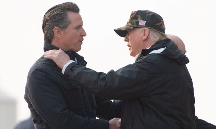President Donald Trump greets California Governor-elect Gavin Newsom (L) as he disembarks from Air Force One upon arrival at Beale Air Force Base in California, on Nov. 17, 2018, as he travels to view wildfire damage. (Saul Loeb/AFP/Getty Images)