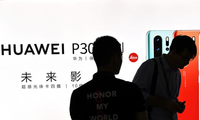 People visit a Huawei stand during the Mobile World Congress at the Shanghai New International Expo Centre in Shanghai on June 26, 2019. (Hector Retamal/AFP/Getty Images)