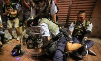 Police Arrest, Beat Hong Kong Protesters Who Gathered at Night After Peaceful March