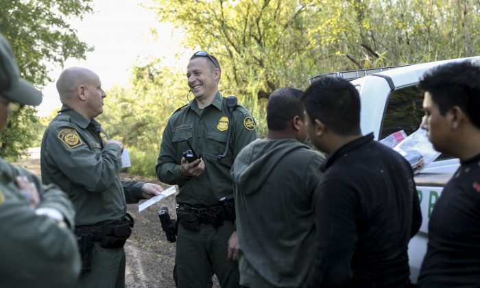 Border Patrol agents apprehend five illegal aliens from Mexico after they tried to evade capture after crossing the Rio Grande near McAllen, Texas, on April 18, 2019. (Charlotte Cuthbertson/The Epoch Times)