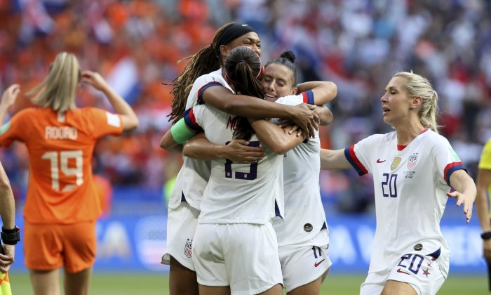 U.S. players celebrate at the end of the Women's World Cup final soccer match between the U.S. and the Netherlands at the Stade de Lyon in Decines, outside Lyon, France, on July 7, 2019. (David Vincent/AP Photo)