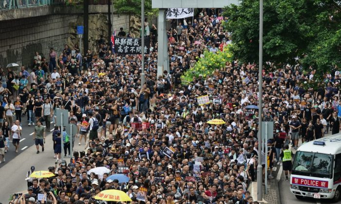 Protesters march Kowloon Park Drive during a protest in Hong Kong on July 7, 2019. (Pang Dawei/The Epoch Times)