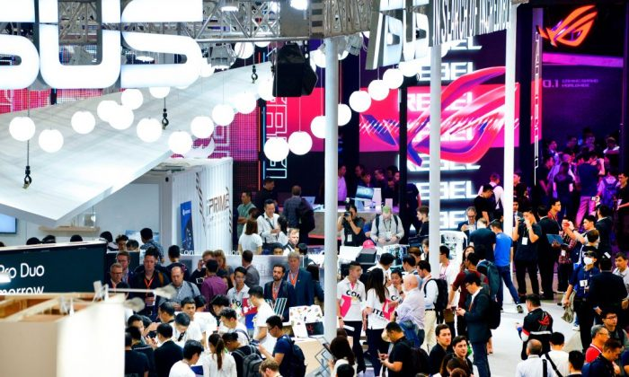 People visit Computex at the Nangang exhibition center in Taipei on May 28, 2019. (Chris Stowers/AFP/Getty Images)