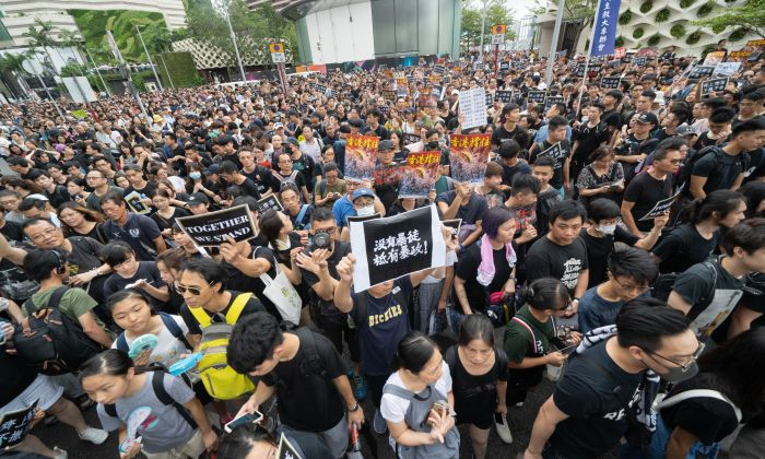 Protesters gather to take part in a march to the West Kowloon railway station against a proposed extradition bill in Hong Kong on July 7, 2019. (Li Yi/Epoch Times)