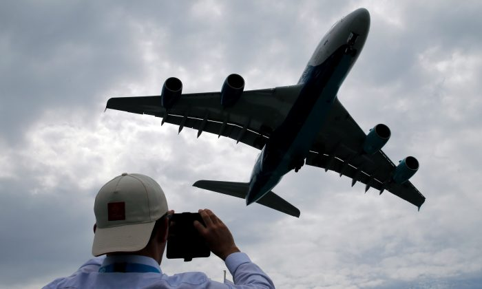 A visitor takes a picture of an Airbus A380 as it lands after an air display at the 53rd International Paris Air Show at Le Bourget Airport near Paris, France on June 23, 2019. (Pascal Rossignol/Reuters)