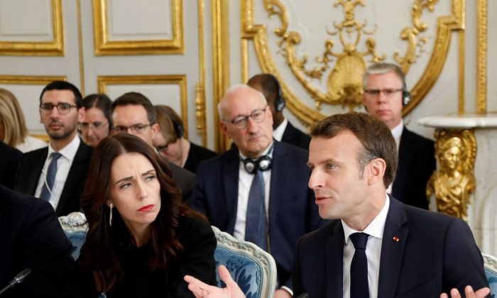 New Zealand Prime Minister Jacinda Ardern and French President Emmanuel at the launching ceremony for the Christchurch Call to Action, an initiative aimed at curbing extremism online, at the Elysee Palace in Paris on May 15, 2019. (AP Photo/Francois Mori)