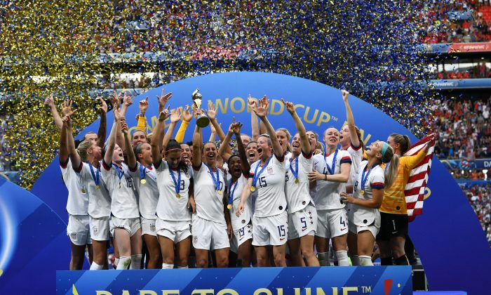 USA's players celebrate with the trophy after the France 2019 Womens World Cup football final match between USA and the Netherlands, on July 7, 2019, at the Lyon Stadium in Lyon, central-eastern France. (FRANCK FIFE/AFP/Getty Images)