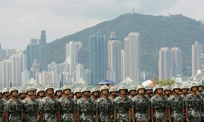 The People's Liberation Army (PLA) soldiers take part in a performance during an open day of Stonecutters Island naval base, in Hong Kong, China on June 30, 2019. (Tyrone Siu/Reuters)