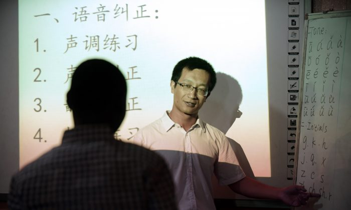 A Chinese language teacher teaches Mandarin at the Confucius Institute at the University of Lagos, Nigeria, on April 6, 2016. Intelligence agencies say Chinese regime-funded Confucius Institutes are a way for China to advance its influence in the host countries, or to be used for espionage purposes by Beijing.  PIUS UTOMI EKPEI/AFP/Getty Images