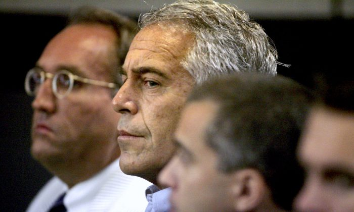 Jeffrey Epstein, center, appears in court in West Palm Beach, Fla. on July 30, 2008. (Uma Sanghvi/Palm Beach Post via AP, File)