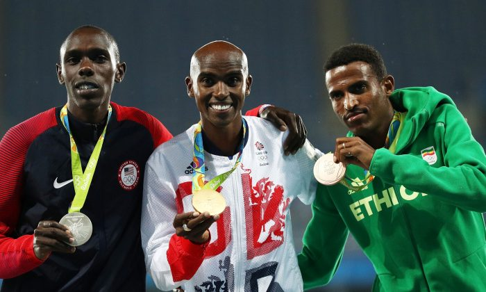 Silver medalist Paul Kipkemoi Chelimo of the United States, gold medalist Mohamed Farah of Great Britain and bronze medalist Hagos Gebrhiwet of Ethiopia stand on the podium during the medal ceremony for the Men's 5000 meter on Day 15 of the Rio 2016 Olympic Games at the Olympic Stadium on August 20, 2016 in Rio de Janeiro, Brazil.  (Photo by Patrick Smith/Getty Images)