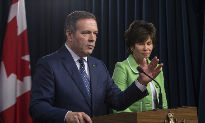Alberta Premier Jason Kenney and Energy Minister Sonya Savage respond to the federal approval of the Trans Mountain Pipeline in Edmonton, Alberta, on June 18, 2019. (THE CANADIAN PRESS/Amber Bracken)