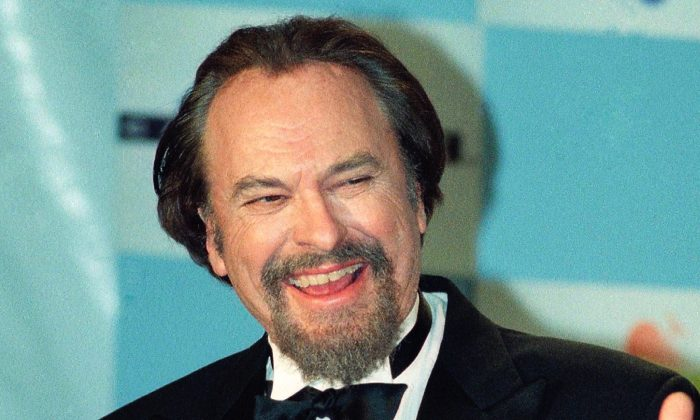 "Actor Rip Torn gives a thumbs-up to photographers after winning for Best Actor in a Comedy Series for HBO's ""The Larry Sanders Show,"" at the 16th annual CableACE Awards ceremony, in Los Angeles on Jan. 15, 1995. (Michael Caulfield/File Photo/AP)"