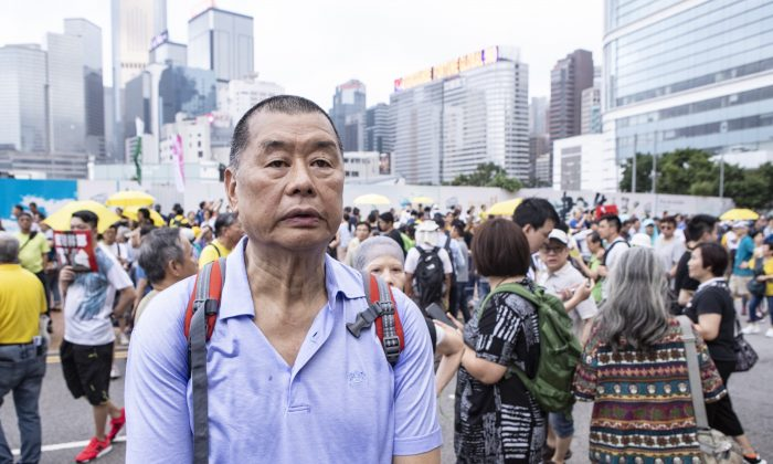Hong Kong media tycoon and democracy campaigner Jimmy Lai joins a protest against a controversial extradition bill in Hong Kong on April 28, 2019. (Yu Gang/Epoch Times)