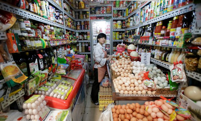 A vendor is seen in her store at a supermarket in downtown Beijing on May 23, 2019. (Jason Lee/Reuters)