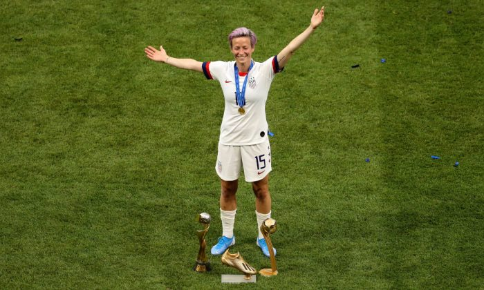 Megan Rapinoe of the USA celebrates with the FIFA Women's World Cup Trophy, the Golden Boot and The Golden Ball following the 2019 FIFA Women's World Cup France Final match between The United States of America and The Netherlands at Stade de Lyon in Lyon, France on July 07, 2019. (Robert Cianflone/Getty Images)