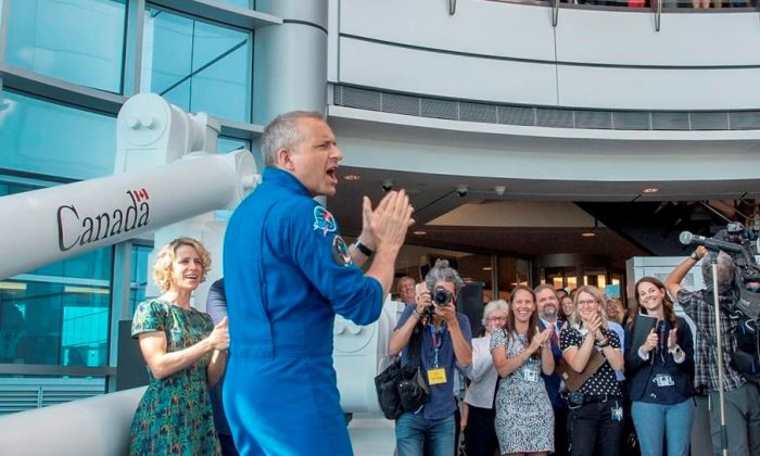 Canadian astronaut David Saint-Jacques is welcomed by colleagues on July 10, 2019 as he arrives at the Canadian Space Agency headquarters in St. Hubert, Quebec. (Ryan Remiorz/The Canadian Press)