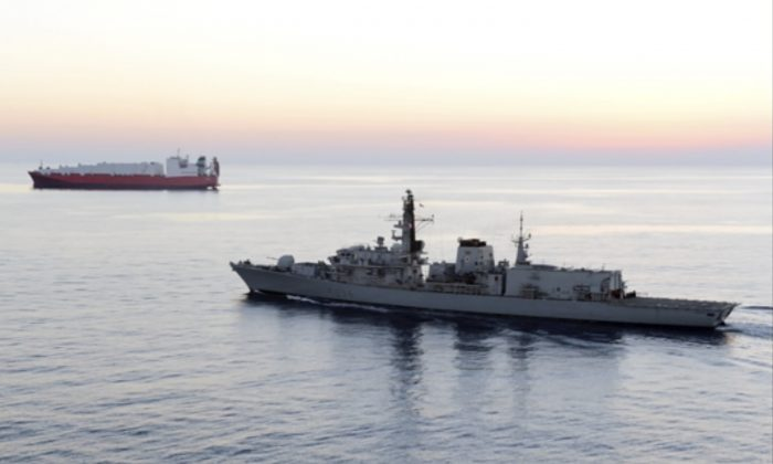 In this image from file video provided by UK Ministry of Defence, British navy vessel HMS Montrose escorts another ship during a mission to remove chemical weapons from Syria at sea off coast of Cyprus in February 2014. (UK Ministry of Defence via AP)