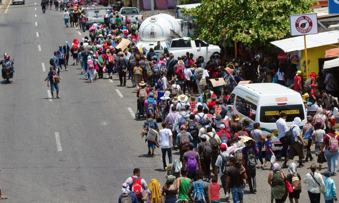 Central American migrants heading in a caravan to the US arrive in Huehuetan, Chiapas state, Mexico, on April 15, 2019. (Pep Companys/AFP/Getty Images)
