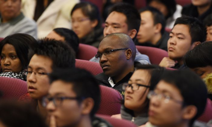 South African and Chinese students listen to a speech by South African President Jacob Zuma at Tsinghua University in Beijing on December 5, 2014. (GREG BAKER/AFP/Getty Images)
