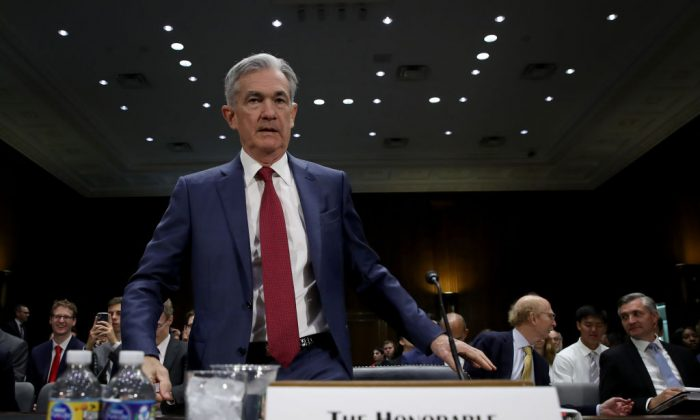 Federal Reserve Board Chairman Jerome Powell arrives for testimony before the Senate Banking, Housing and Urban Affairs Committee in Washington, DC on July 11, 2019. (Win McNamee/Getty Images)