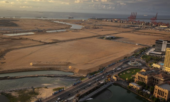 Built on land reclaimed from the Indian Ocean and funded with $1.4 billion in Chinese investment, the Colombo Port City project is seen jutting out into the ocean that will eventually be 65 million cubic meters of sand in Colombo, Sri Lanka on Nov. 20, 2018. (Paula Bronstein/Getty Images)