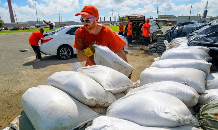 St. Bernard Parish Sheriff's Office inmate workers move free sandbags for residents in Chalmette, La., on July 11, 2019. (Matthew Hinton/AP)