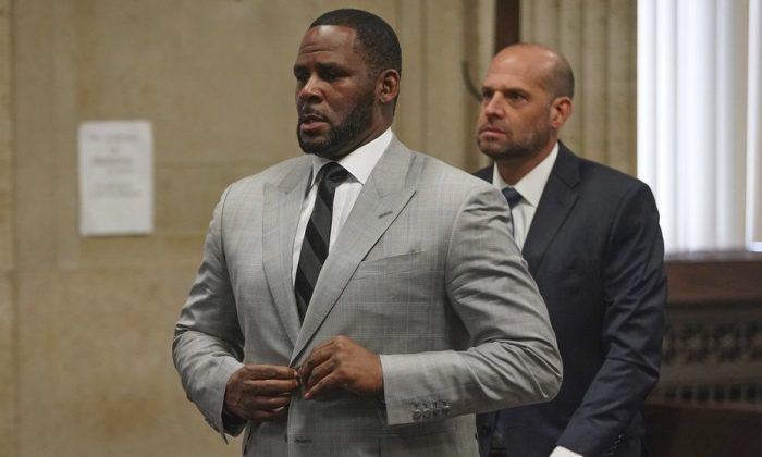 Singer R. Kelly pleads not guilty to 11 additional sex-related felonies during a court hearing in Chicago on June 6, 2019.  (E. Jason Wambsgans/Chicago Tribune via AP, Pool)