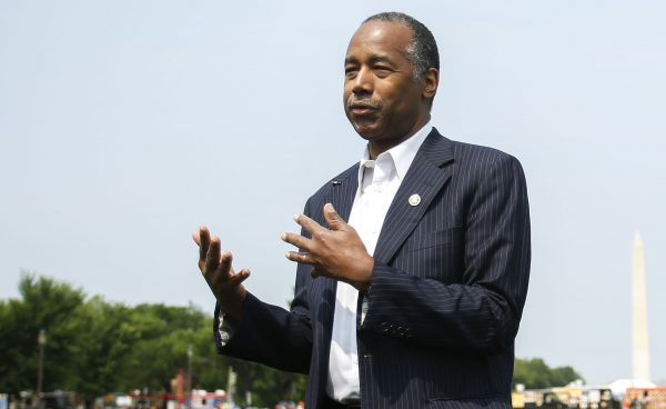 Secretary of Housing and Urban Development Ben Carson answers questions from the press after delivering remarks at the Innovative Housing Showcase on the National Mall in Washington