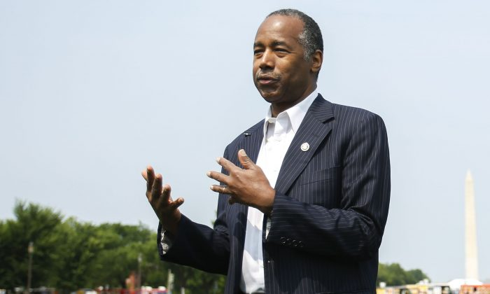 Secretary of Housing and Urban Development Ben Carson answers questions from the press after delivering remarks at the Innovative Housing Showcase on the National Mall in Washington on June 1, 2019. (Samira Bouaou/The Epoch Times)