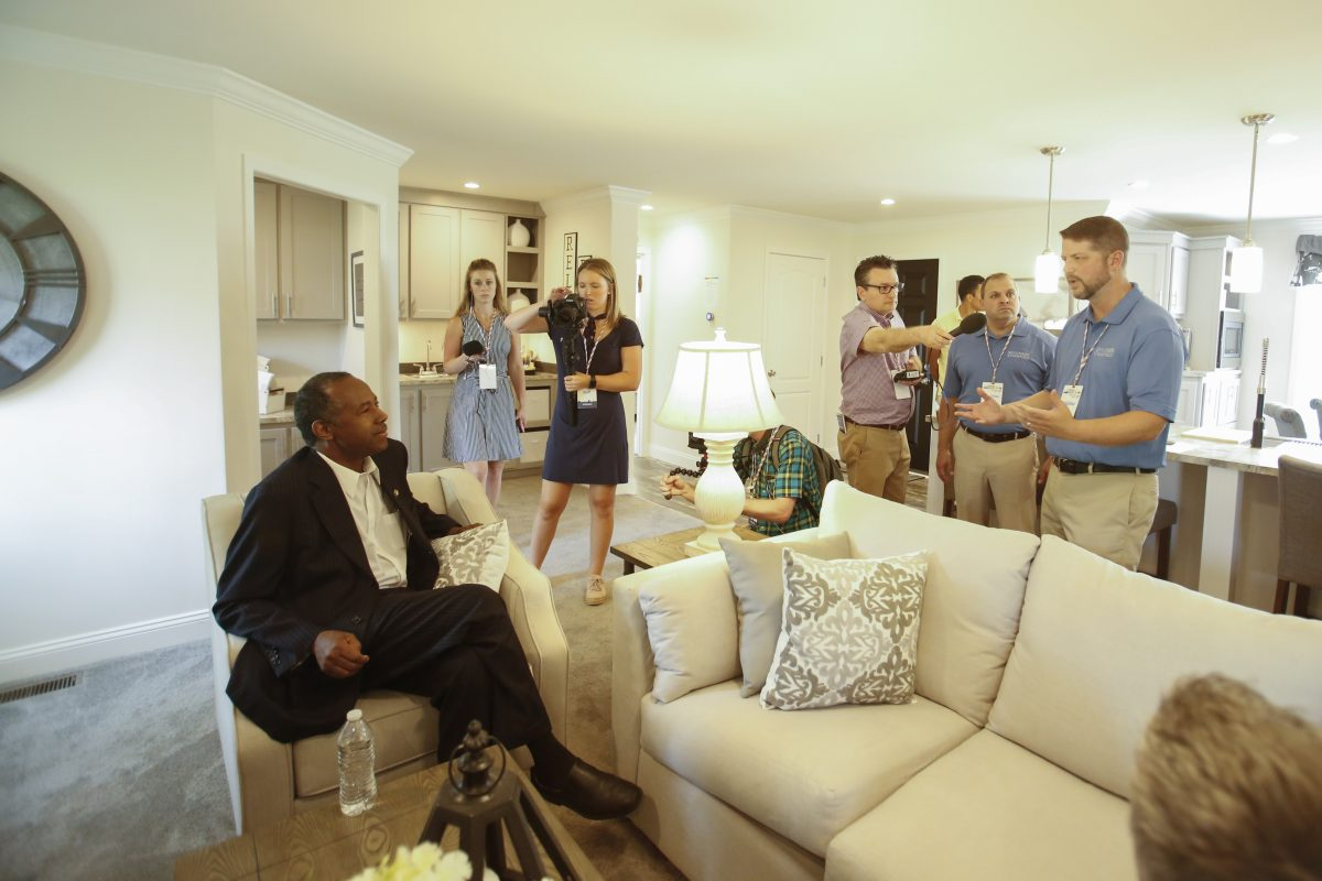 Secretary of Housing and Urban Development Ben Carson (L) visits a house by Skyline Champion homebuilders at the Innovative Housing Showcase on the National Mall in Washington