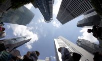 Singapore Cautions Wealth Managers on Aggressively Courting Hong Kong Business