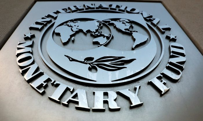 The International Monetary Fund (IMF) logo is seen outside the headquarters building in Washington, U.S. on Sept. 4, 2018. (Yuri Gripas/Reuters)