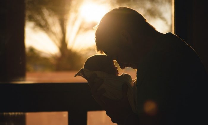 Stock image of a baby and father. (StockSnap/Pixabay)
