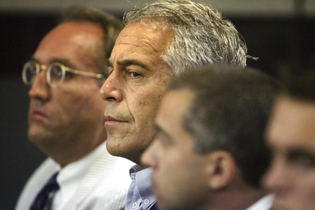 Jeffrey Epstein, center, appears in court in West Palm Beach