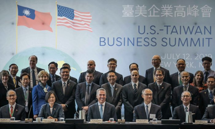 Taiwan President Tsai Ing-we, seated second from left, pose with participants at the U.S. Taiwan Business Summit in New York on July 12, 2019. (AP Photo/Bebeto Matthews)