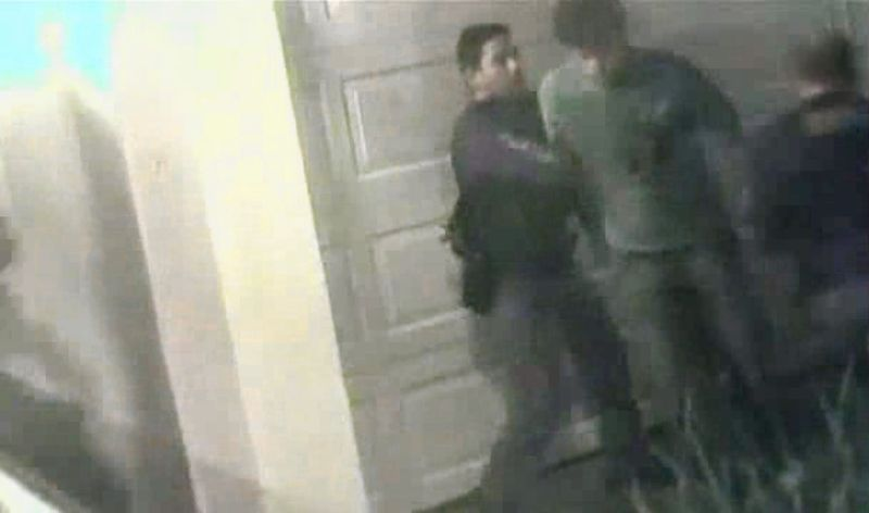 A still from footage of an arrest.