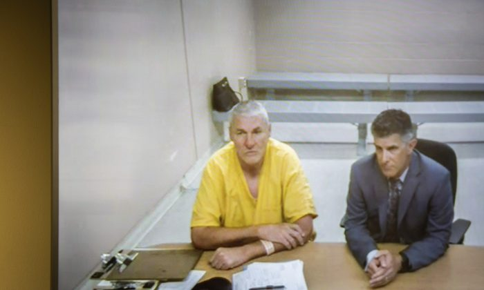 Former Washington State quarterback and Superbowl MVP Mark Rypien appears alongside defense attorney Chris Bugbee via video conference for a hearing presided over by commissioner Kristin O'Sullivan on in Spokane, Washington on July 1, 2019. (Libby Kamrowski/The Spokesman-Review via AP)
