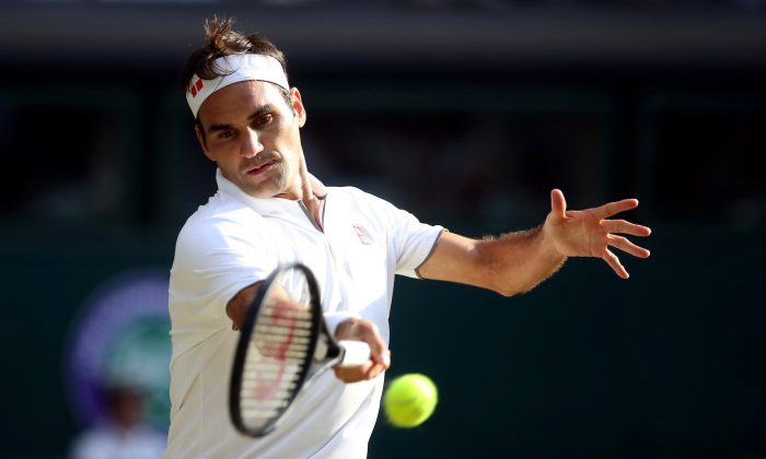 Switzerland's Roger Federer in action during his semi-final match against Spain's Rafael Nadal  at Wimbledon in the All England Lawn Tennis and Croquet Club, London, Britain, on July 12, 2019. (Carl Recine/Reuters)