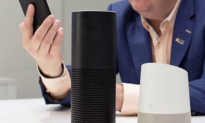 An Amazon Echo, center, and a Google Home, right, are displayed. (Mark Lennihan/AP Photo)