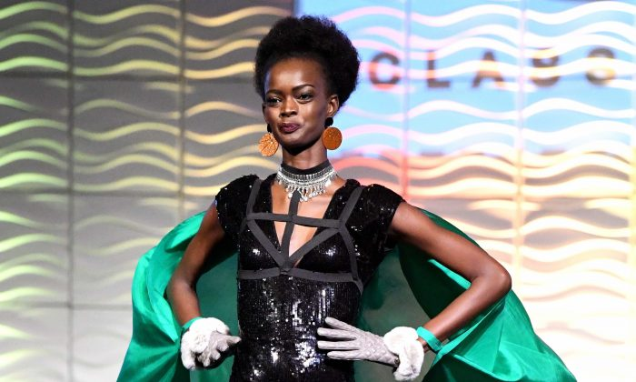 Contestant Adau Mornyang of Victoria competes at the 2017 Miss World Australia National Final, at the Grand Hyatt in Melbourne, Australia, on July 14, 2017. (AAP Image/Joe Castro)