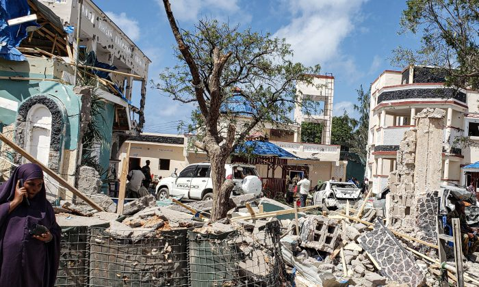 A view taken on July 13, 2019 shows the rubbles of the popular Medina hotel of Kismayo, a day after at least 26 people, including several foreigners, were killed and 56 injured in a suicide bomb and gun attack claimed by Al-Shabaab terrorist group. (Stringer/AFP/Getty Images)