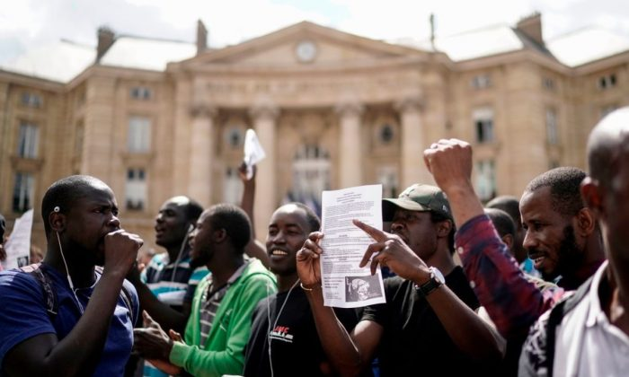 Illegal migrants demonstrate in front of the Pantheon in Paris to ask the French government to give them residency papers on July 12, 2019. (Kenzo TRIBOUILLARD / AFP)