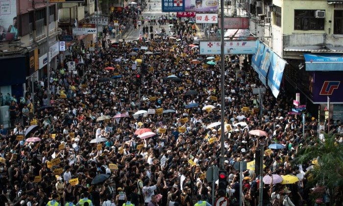Protesters attend a march at an anti-parallel trading in Sheung Shui district in Hong Kong on July 13, 2019. (PHILIP FONG/AFP/Getty Images)