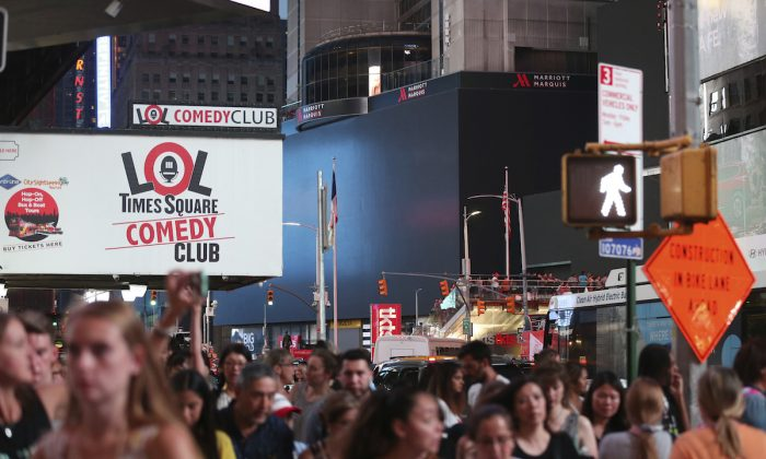 Screens in Time Square are black during a widespread power outage in New York, on July 13, 2019. (Michael Owens/AP Photo)