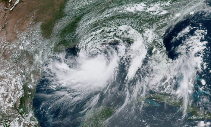 Satellite imagery of Tropical Storm Barry approaching the coast of Louisiana, U.S., from the Gulf of Mexico on July 12, 2019. (NOAA/Handout via Reuters)