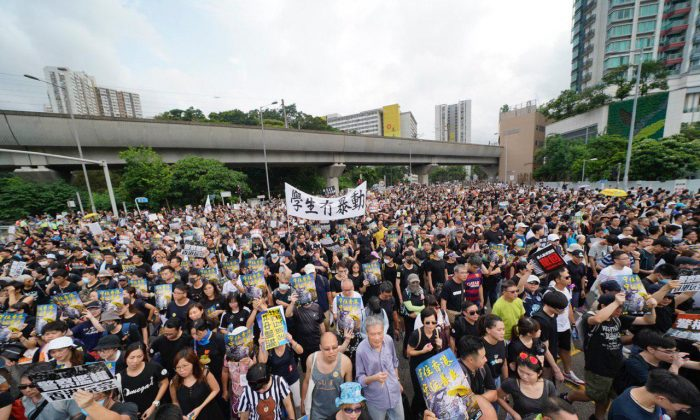 Protesters attend a rally against a controversial extradition law proposal in Sha Tin district of Hong Kong on July 14, 2019. (Yu Kong/The Epoch Times)