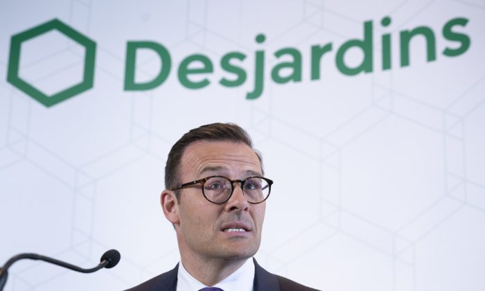 Desjardins President and CEO Guy Cormier reads a statement during a news conference in Montreal on June 20, 2019. (Paul Chiasson/The Canadian Press)