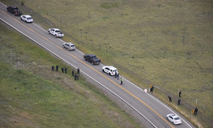 Police investigate the scene of a shooting along Highway 1A near Morley, AB., in this August 2018 police handout photo. (HO/The Canadian Press)